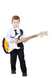 Little boy with a guitar in hands Stock Photos