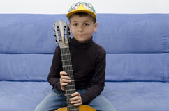 Little boy and a guitar Royalty Free Stock Image