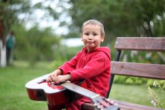 Little boy with guitar Royalty Free Stock Photos