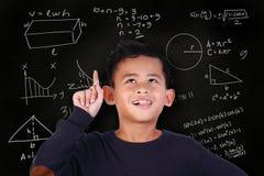 Little Boy ha risolto il problema per la matematica Fotografia Stock