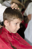 Little boy at the hair dresser Royalty Free Stock Image