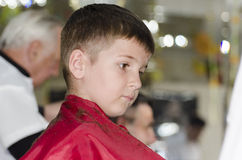 Little boy at the hair dresser Stock Photography