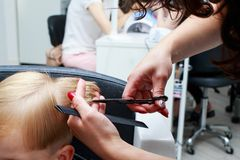Cutting hair of child royalty free stock photos