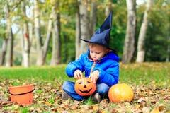 Little boy in halloween costume at autumn park Stock Photo