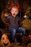 Little boy on Halloween party  with pumpkin Royalty Free Stock Photo
