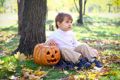 Little boy with halloween pumpkin Royalty Free Stock Image