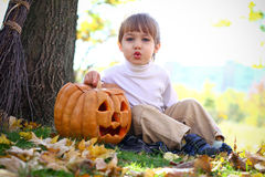 Little boy with halloween pumpkin Royalty Free Stock Photo