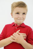 Little Boy With Hand On Heart Royalty Free Stock Photography