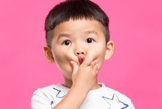 Little boy with hand touch on his cheek. Asian young little boy royalty free stock image