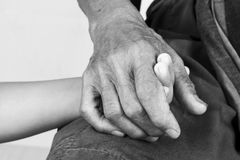 little boy hand touches and holds an old man wrinkled Royalty Free Stock Image