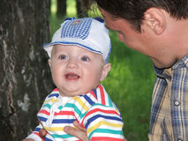 The little boy on hands of father. Royalty Free Stock Images