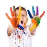 Little boy with hands painted in colorful paints Stock Photos
