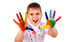 Little boy with hands painted in colorful paints Royalty Free Stock Photo