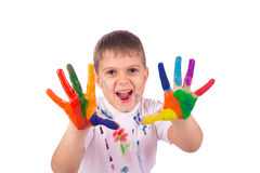 Little boy with hands painted in colorful paints Royalty Free Stock Images