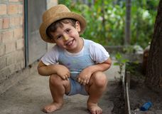 Little boy hands painted in colorful paints. Happy kid having fun outdoors. stock images