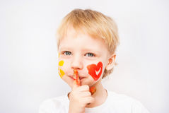 Little boy hands painted in colorful paints. Heart on face stock images