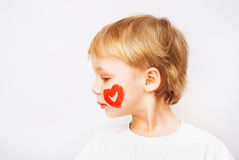 Little boy hands painted in colorful paints. Heart on face stock image