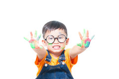 Little boy with hands painted in colorful Stock Photo
