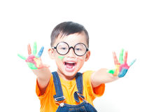 Little boy with hands painted in colorful Stock Images