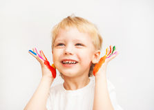 Little boy hands painted in colorful paints. On white stock photo