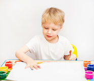 Little boy hands painted in colorful paints. On white stock image