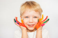 Little boy hands painted in colorful paints Stock Image