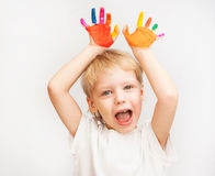 Little boy hands painted in colorful paints. On white royalty free stock images
