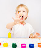 Little boy hands painted in colorful paints Stock Photos