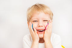 Little boy hands painted in colorful paints stock images