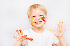 Little boy hands painted in colorful paints. On white stock photography