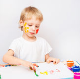 Little boy hands painted in colorful paints. On white royalty free stock photo
