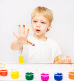 Little boy hands painted in colorful paints. On white royalty free stock image