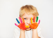 Little boy hands painted in colorful paints Stock Photo