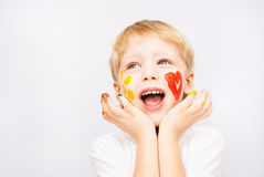 Little boy hands painted in colorful paints. On white stock photos