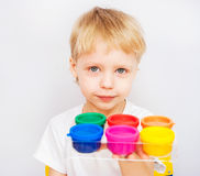 Little boy hands painted in colorful paints Stock Photography