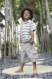 Little Boy With Hands In Pockets On Stepping Stone Royalty Free Stock Photography