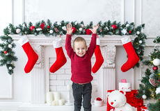 The little boy with the hands raised up celebrates Christmas and new year. Royalty Free Stock Photo