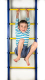 Little boy hanging on hands Stock Image