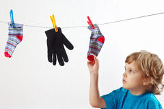 Little boy hanging your clothes Royalty Free Stock Images