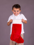 Little boy happy with Christmas stocking Stock Images