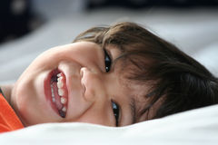 Little boy happy on his back Royalty Free Stock Photos