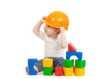Little boy with hard hat and building blocks Royalty Free Stock Image