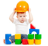 Little boy with hard hat and building blocks Stock Image