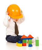 Little boy with hard hat and building blocks. Toys royalty free stock photos