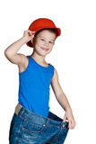 Little boy with hard hat and in too big jeans Royalty Free Stock Photos