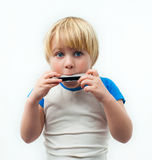 Boy with harmonica Stock Photo