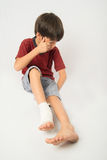 Little boy has an accident with his leg need bandage for first aid Stock Image