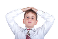 The little boy has put hands on a head. On a white background Stock Photo