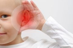 Little boy has a sick ear. Close up royalty free stock image