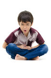 Little boy has stomach ache on white background stock photo